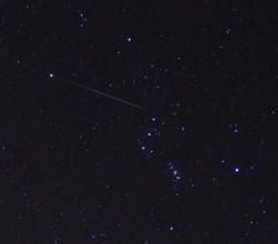 A bright Geminids meteor trail
