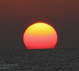 Three sunspots of Solar Cycle 24 were captured without any filter at sunset from Seri Kenangan Beach, Tutong on August 01, 2011. (Canon EOS 400D Lens EF-S18-135mm f/3.5-5.6 IS Focal Length 135.0mm)