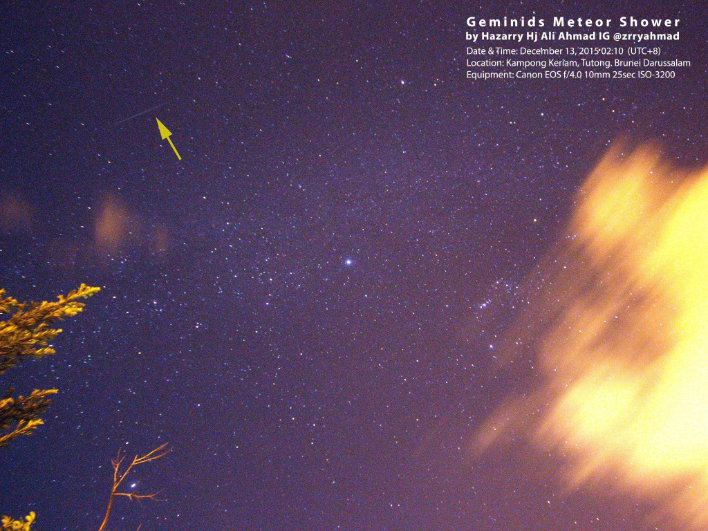 A bright meteor streak of light in the sky (indicates by the arrow)